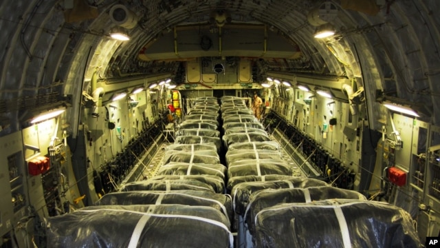 A U.S. Defense Department photo shows pallets of bottled water are loaded aboard a U.S. Air Force C-17 Globemaster III aircraft in preparation for a humanitarian airdrop over Iraq Aug. 8, 2014.