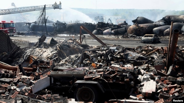 Remains of a home lie in rubble as firefighters continue working at scene of a train derailment, Lac Megantic, Quebec, July 7, 2013.