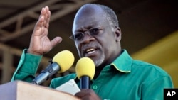 Tanzanian President John Pombe Magufuli gestures during a rally in Dar es Salaam, Tanzania, Oct. 23, 2015. At first, Magufuli appeared keen on ending corruption and wasteful government spending, but then came descrees that many consider undemocratic.