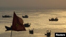 Fishing boats are seen on bay of Ly Son islands of Vietnam's central Quang Ngai province, April 10, 2012.