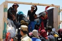 Fallujadan qochib ulgurgan oddiy fuqarolar