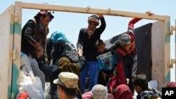 Des civils ont été déplacés de Fallujah afin de fuir les combats entre les forces irakiennes et les militaires du groupe islamique en Irak, le 26 mai 2016.