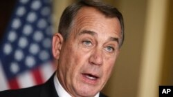 FILE: House Speaker John Boehner of Ohio responds to President Barack Obama's intention to spare millions of illegal immigrants from being deported, a use of executive powers that is setting up a fight with Republicans in Congress over the limits of presidential powers, Nov. 21, 2014.