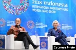 Jim Yong Kim dan Christine Lagarde meluncurkan Bali Fintech Agenda. (Foto courtesy: Bank Dunia).