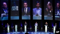 Presidential candidates Adolfo Rodriguez Saa, left, Sergio Massa, second left, Nicolas del Cano, third left, Margarita Stolbizer, second right, and Mauricio Macri attend the debate between presidential hopefuls in Buenos Aires, Argentina, Oct. 4, 2015.