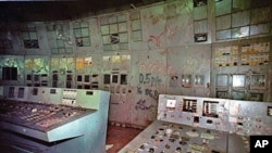 The control room and its damaged machinery is seen inside reactor No. 4 in the Chernobyl nuclear power plant in Ukraine, November 2000 (file photo)