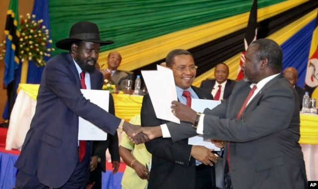 FILE - South Sudan's President Salva Kiir, left, is seen shaking hands with rebel leader Riek Machar, right, following a previous round of peace talks.