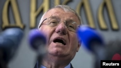 Serbian nationalist leader Vojislav Seselj speaks during a news conference inside his Serbian Radical Party headquarters in Belgrade, April 2, 2015. The Serbian ultra-nationalist, freed on compassionate grounds by a United Nations war crimes court, then ordered to return for violating the terms of his release, thumbed his nose at the court on Wednesday by setting fire to a Croatian flag.