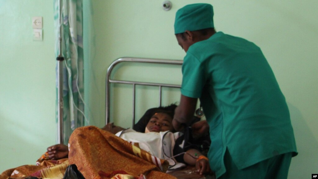FILE - A person is treated, at a public hospital in Antananarivo, Madagascar.