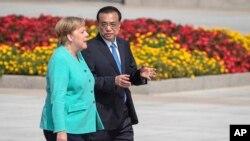 中國總理李克強與德國總理默克爾在北京人大會堂前出席歡迎儀式。 (2019年9月6日)