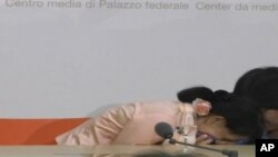 Burmese opposition leader Aung San Suu Kyi briefly falls ill in Switzerland, Jun 14, 2012