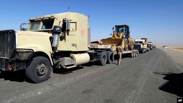 FILE - Iraqi security forces are seen amassing hardware in the city of Shirqat near Mosul, Iraq, Sept. 20, 2016, as part of operations to retake Mosul from IS militants.