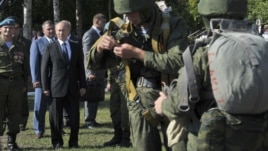 Russian President Vladimir Putin (2nd L, 1st row) visits the base of the independent airborne assault brigade number 31, on the eve of the Paratroopers' Day, in the city of Ulyanovsk, Russia, August 1, 2012.