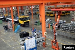FILE - A factory floor of XCMG Group is seen in Xuzhou, Jiangsu province, China, Aug. 14, 2015. In the years since China unveiled a sweeping plan to rebuild Silk Road trade links with Europe and Asia, machinery maker XCMG Group has opened a factory in Uzbekistan, sent 300 staff abroad and set ambitious goals to grow overseas. XCMG's foreign venture piggybacks on China's bold scheme to extend its global influence through financing infrastructure projects in 65 nations that are home to two-thirds of humanity, and at the same time win new markets for companies weighed down by profit-crushing overcapacity at home.