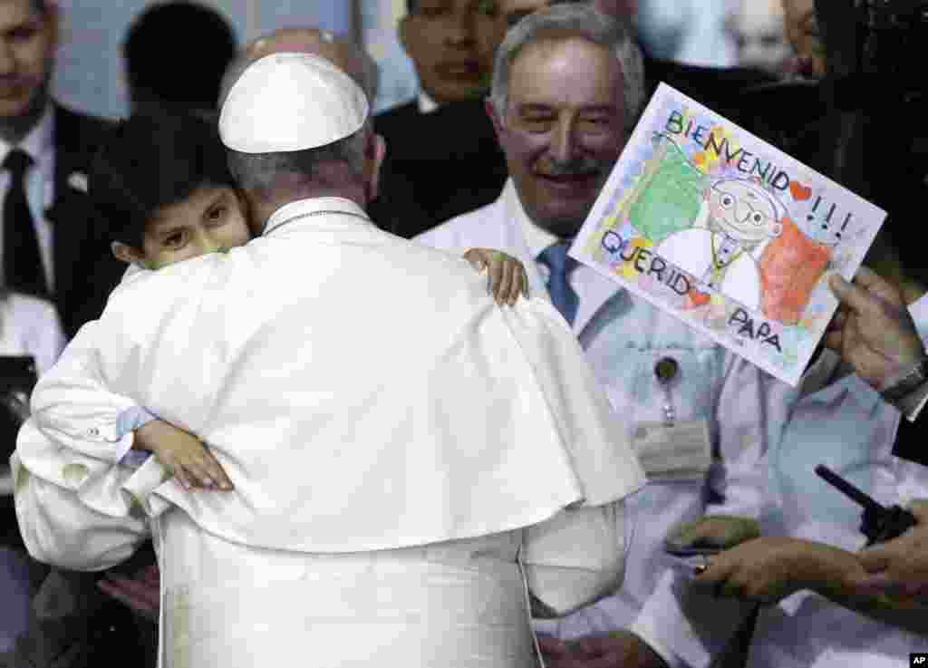 Five-year-old Rodrigo Lopez Miranda embraces Pope Francis, during his visit to the Federico Gomez Pediatric Hospital, in Mexico City, Feb. 14, 2016.