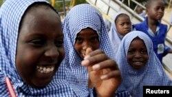 Schoolgirls play outside El-Kanemi Islamic School, where both Western and Islamic curriculums are taught, in Maiduguri.