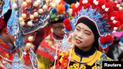 Children wearing costumes wait to perform during an event to celebrate the Chinese Lunar New Year, in Nanjing, Jiangsu province, China February 2, 2019.