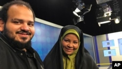 In this undated photo provided by Iranian state television's English-language service, Press TV, American-born news anchor Marzieh Hashemi, right, smiles as she stands with her son, Hussein Hashemi, in Tehran, Iran.