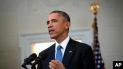 奥巴马在白宫内阁室宣布美国将改变长期以来的古巴政策。(2014年12月17日)