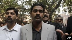 Mohammed Wasim, center, whose brother Mohammed Fahim was shot and killed by Raymond Davis, arrives at a central jail for Davis' hearing in Lahore, Pakistan, March 14, 2011