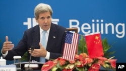 Menlu AS John Kerry di Beijing (7/6).