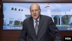 Perdana Menteri baru Lebanon, Najib Mikati berpidato setelah pengumuman kabinet Lebanon di Beirut (13/6).