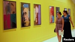 Visitors at Pera Museum in Istanbul look at artwork by Andy Warhol, June 10, 2014.