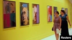 Visitors at Pera Museum in Istanbul look at artwork by Andy Warhol, June 10, 2014.