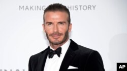 Soccer legend David Beckham poses for photographers upon arrival at the amfAR charity gala during the Cannes 70th international film festival, Cap d'Antibes, southern France, May 25, 2017. Beckham, who is married to fashion mogul Victoria Beckham, will launch 21 men's grooming products under the name House 99 on Feb. 1 in the United Kingdom, exclusively at Harvey Nichols stores.
