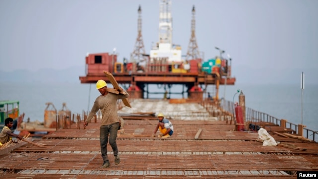 Workers from Indian conglomerate Essar Group construct a new port  in Sittwe in Rakhaine state, Burma, May 19, 2012.