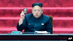 FILE - North Korean leader Kim Jong Un holds up parliament membership certificate during the Supreme People's Assembly in Pyongyang, North Korea.