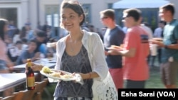 International students from around the world -- like Arina Zaytseva, a Ph.D. candidate in religious studies from Russia -- are starting schools at colleges and universities around the U.S. To help them understand insurance requirements and visa specifications, schools like Rice University in Houston, Texas, bring them together for food and drink, too.