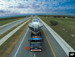 Robert Swan trucked a sailboat overland in Africa to raise awareness about the environment and HIV/AIDS