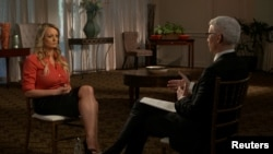 "FILE - Stormy Daniels, an adult film star and director whose real name is Stephanie Clifford, is interviewed by Anderson Cooper of CBS News' ""60 Minutes"" program in early March 2018, in a still image from video provided March 25, 2018."