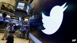 FILE - In this July 27, 2016, file photo, the Twitter symbol appears above a trading post on the floor of the New York Stock Exchange. Twitter, long criticized as a hotbed for online harassment, is expanding ways to curb the amount of abuse users see and making it easier to report such conduct. (AP Photo/Richard Drew, File)