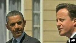 美国总统奥巴马和英国首相卡梅伦承诺在利比亚展开不间断的军事行动