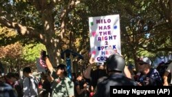 Signs supporting a planned speech by Milo Yiannopoulos in Berkeley, California on Sunday, Sept. 24, 2017 following a protest of another speech of his at the University of California, Berkeley earlier that year.