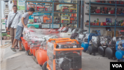 Two men are looking to buy electricity generators at a local shop in Phnom Penh, Cambodia, May 11, 2019. (Khan Sokummono/VOA Khmer)