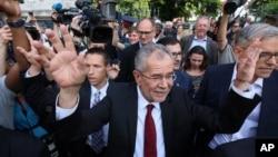 FILE - Alexander Van der Bellen, winner of Austria's presidential election, waves to his supporters in Vienna, May 23, 2016.
