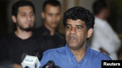 Abdullah Al-Senussi, head of the Libyan Intelligence Service speaks to the media in Tripoli August 21, 2011.