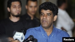 Abdullah Al-Senussi, head of the Libyan Intelligence Service speaks to the media in Tripoli August 21, 2011.
