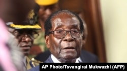 Zimbabwean President Robert Mugabe is seen upon arrival for his annual State of the Nation address at Parliament in Harare, Tuesday, Dec. 6, 2016.
