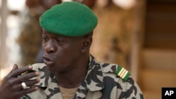 FILE - Capt. Amadou Haya Sanogo addresses the press at junta headquarters in Kati, outside Bamako, Mali, March 30, 2012.