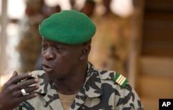 FILE - Coup leader Capt. Amadou Haya Sanogo addresses the press at junta headquarters in Kati, outside Bamako, Mali, March 30, 2012.