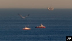 Rescue boats search for wreckage from two small planes that collided in midair and plunged into the ocean off of Los Angeles harbor, Feb. 5, 2016 in San Pedro, Calif.