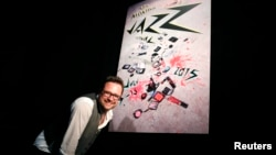 Montreux Jazz Festival Director Mathieu Jaton poses in front of the MJF poster after a press conference to announce performers booked at the 49th annual edition of the famed Swiss festival in July in Lausanne, April 16, 2015.