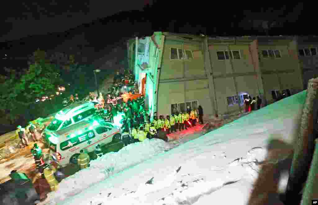 Rescue workers search for survivors from a collapsed resort building in Gyeongju, South Korea, Feb. 17, 2014.