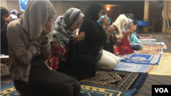 Uighur Muslim women pray as part of Eid festivities in Falls Church, Virginia, Aug. 21, 2018. (B. Gallo/VOA)