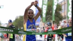 Atileeti Eebbisaa Maragaa Ijjiguu maratoonii Kubek, Kanadaa moo'ee mallattoo mormii Oromoo garsiise