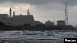 FILE - Tokyo Electric Power Co.'s (TEPCO) Kashiwazaki Kariwa nuclear power plant, which is the world's biggest, is seen from a seaside in Kashiwazaki, Nov. 12, 2012.